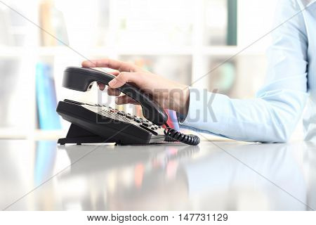 woman hand with office phone on desk