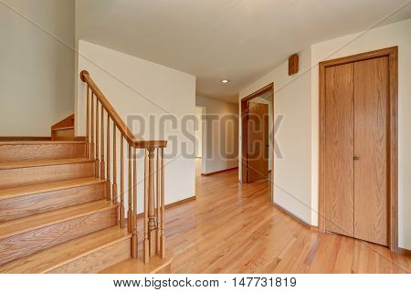 Hallway Interior With Hardwood Floor. View Of Wooden Stairs.