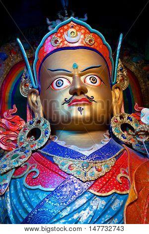 LEH, INDIA - JUNE 12, 2012: Statue of Guru Padmasabhava at Hemis Gompa in Ladakh, Jammu and Kashmir State of India. Padmasabhava is known also as Guru Rinpoche.