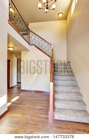 Hallway Interior With Hardwood Floor. View Of Carpet Floor Stairs.
