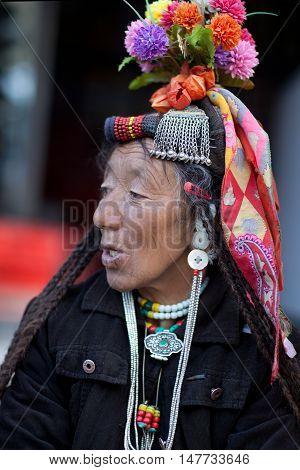 LEH, INDIA - JUNE 14, 2012: Drokpa woman in national clothes poses for a photo during Yuru Kabgyat festival.