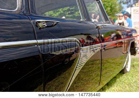 Kharkiv Ukraine - May 22 2016: Close up of Soviet retro car black GAZ-13 Chayka manufactured between 1959 and 1981 is presented at the festival of vintage cars Kharkiv Retro Rally - 2016 in Kharkiv Ukraine on May 22 2016