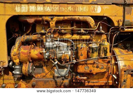 ROLLAG, MINNESOTA, September 1, 2016: The external parts of a tractor engine is a Minneapolis Moline , a company created from the merger of Minneapolis Steel & Machinery (MSM), Minneapolis Threshing Machine, and Moline Plow and headquartered in Hopkins, M