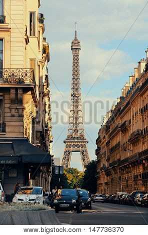 PARIS, FRANCE - MAY 13: Eiffel Tower and street view on May 13, 2015 in Paris. With the population of 2M, Paris is the capital and most-populous city of France