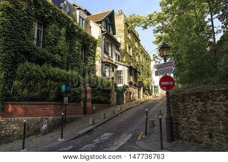 PARIS, FRANCE - MAY 12, 2015: Rue Cortot is one of the oldest and most picturesque streets of Montmartre.