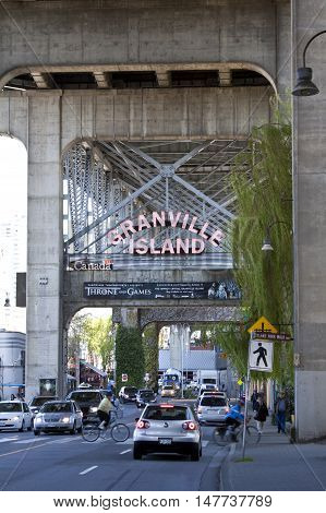 Vancouver, BC - April 20, 2015 - Photo of the entrance to Granville Island, which is a peninsula beneath the south end of Granville Street Bridge. In the 70s it was transformed into a vibrant tourist attraction, with a famous market, restaurants, specialt
