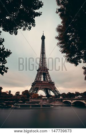 Eiffel Tower with bridge in River Seine in Paris, France.