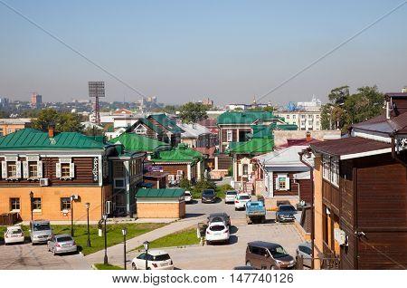 IRKUTSK RUSSIA - 17 SEPTEMBER 2016: Street with typical Russian log cabins located in the Irkutsk Sloboda (130 Quarter).