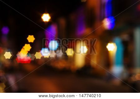 Vintage city night light bokeh and chrismas light star shape blurred background