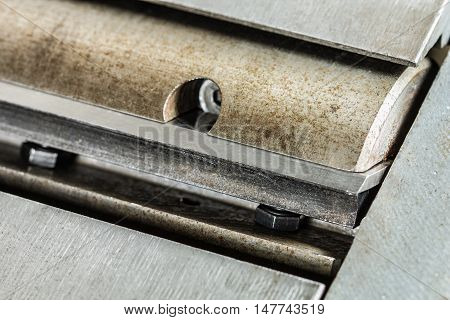 Shaft with sharp knives of woodworking jointer сlose-up