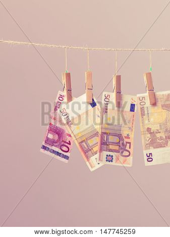 Banknotes cash money hang on laundry line. Filtered.