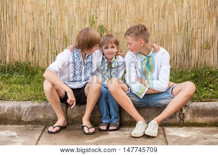 Ukrainian boys in traditional shirt of different age in rural areas