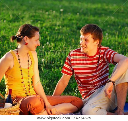 Couple on picnic at sunny day