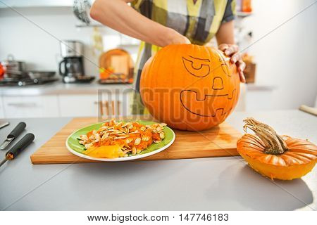 Closeup On Housewife Prepare Orange Pumpkin For Halloween Party