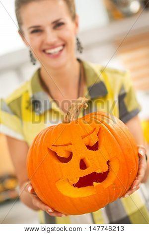 Closeup On Housewife Showing Big Pumpkin Jack-o-lantern