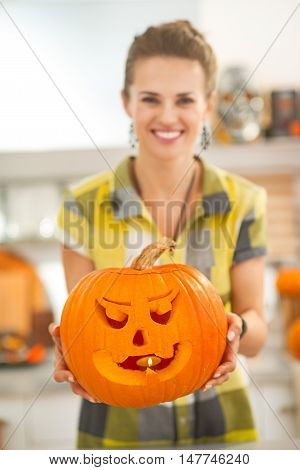 Closeup On Housewife Showing Pumpkin Jack-o-lantern With Candle