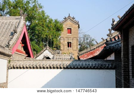 Traditional chinese buildings within the Kong Family mansion property in the city of Qufu located in Shandong Province China.
