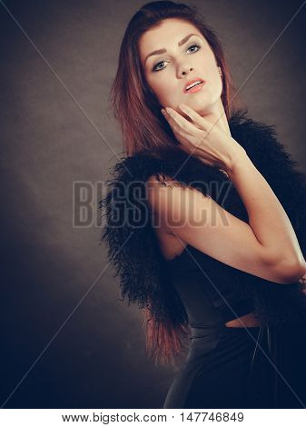Woman In Sensual Black Dress On Dark