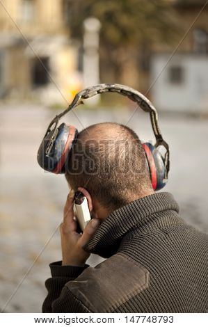 Man with old headphones in the street