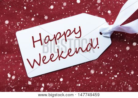 One White Label On A Red Textured Background. Tag With Ribbon And Snowflakes. English Text Happy Weekend
