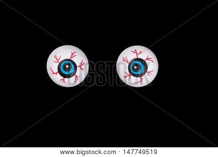 Scary eyeballs for Halloween season isolated on black background.