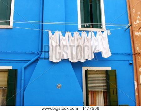 Coloured House With Hanging Out Clothes
