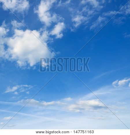 Blue sky and white clouds over horizon. Beautifull blue sky.