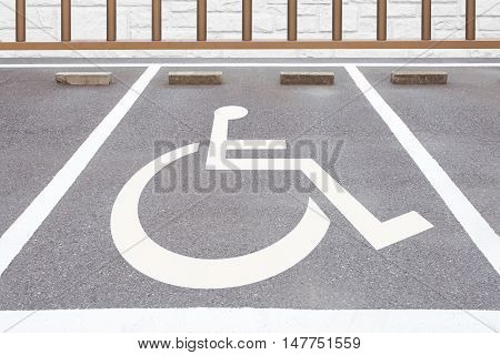 Outdoor empty handicapped space at car parking lot