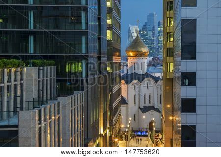 Temple of St. Nicholas in Tverskaya Zastava between two office buildings in evening Moscow, Russia