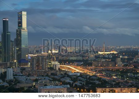 Third transport ring highway and skyscrapers in night Moscow, Russia