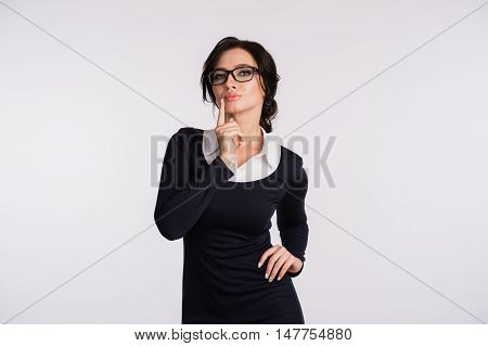 pretty woman making silence sign over white background.