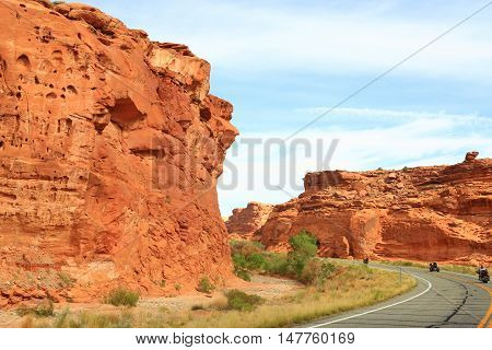 Motorcycles riding the winding roads through Glen Canyon National Park