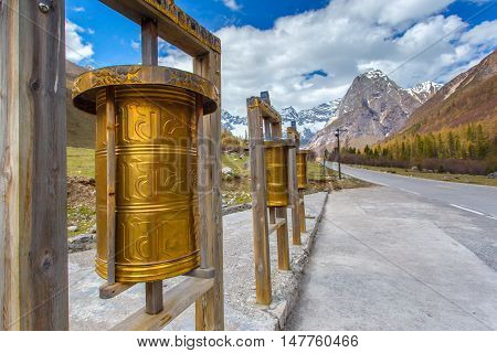 Maiden's Mountain (Mt.Siguniangshan) Scenic Area is an unspoiled wilderness park located in western china and Qiang Autonomous Prefecture at Prayer wheels foreground Sichuan Province China. selective focus