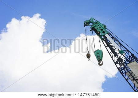 Hoist/crane with blue sky and cloud in background