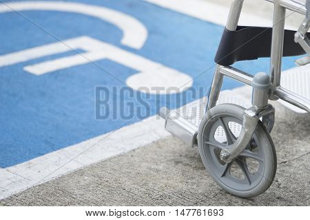 Pavement handicap symbol and sign with wheelchair