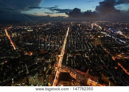 Beautiful aerial night view of Taipei, Taiwan with busy traffic light trails on the Xinyi Road