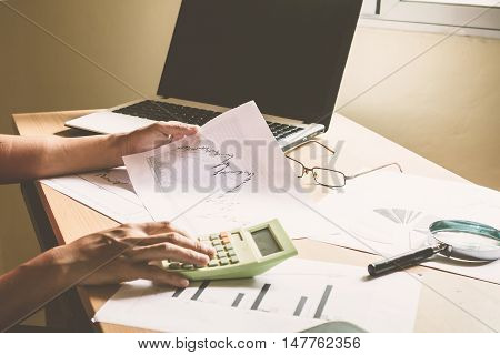 Computer, stock charts, on a desk / Concept : Analysis of Stock on a desk