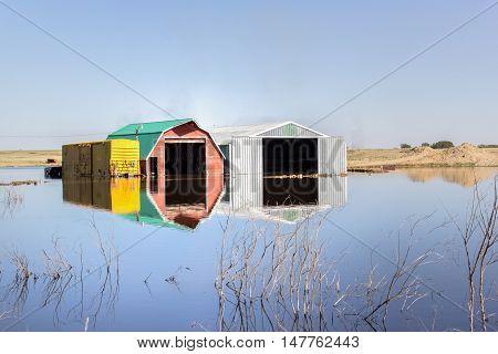 buildings sitting in a flooded farm field