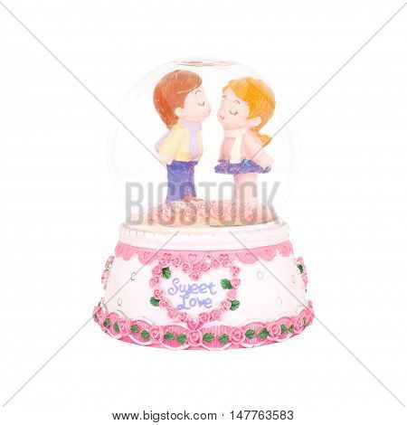 Plaster lovely couple doll in snow globe isolated on white background with clipping path