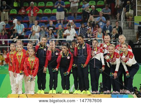 RIO DE JANEIRO, BRAZIL - AUGUST 9, 2016: Women's team all-around gymnastics winners at Rio 2016 Olympic Games team China (L), team USA  and team Russia during medal ceremony at Rio Olympic Arena