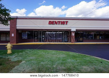 BOLINGBROOK, ILLINOIS / UNITED STATES - SEPTEMBER 17, 2016: One may have dental work performed at the Marketplace at Barber's Corner strip mall in Bolingbrook.