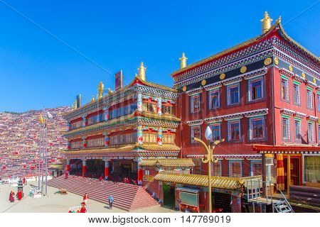 Red monastery at Larung gar (Buddhist Academy) in sunshine day and background is blue sky Sichuan China