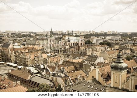 Poznan, Poland - June 28, 2016: Vintage Photo, View On Buildings And Collegiate Church In Polish Tow