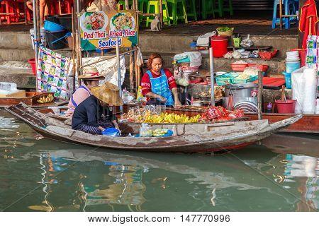 Ratchaburi Thailand- March 20 2016 : Damnoen Saduak Floating Market tourists visiting by boat located in Ratchaburi Thailand.