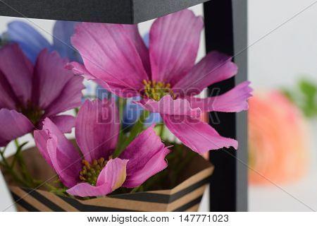 A pot of beautiful pink artificial flower