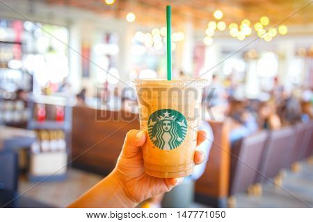 Bangkok Thailand- FEB 22 2016: Espresso Blended Beverages served in the hand inside of starbuck shop at Siam Paragon Bangkok Thailand.