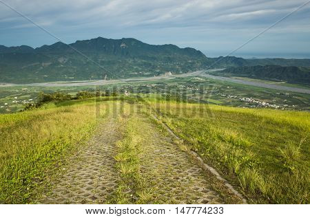 landscape of famous Dulan mountain and grassland under sky in Taitung, Taiwan, Asia
