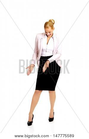 Business woman pointing down at her shoe