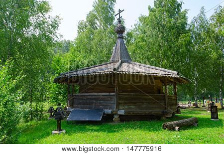 KOSTROMA RUSSIA - JULY 20 2016: Unidentified people visit Kostroma Architectural-Ethnographic and Landscape Museum-Reserve Kostromskaya Sloboda. Chapel from village Bolshoe Tokarevo of Soligalichsky District of Kostroma region