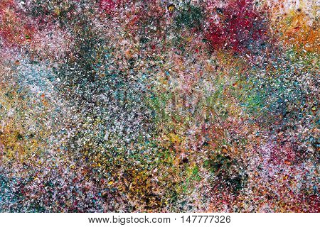 Abstract background of small colorful bed of chips, topped with varnish